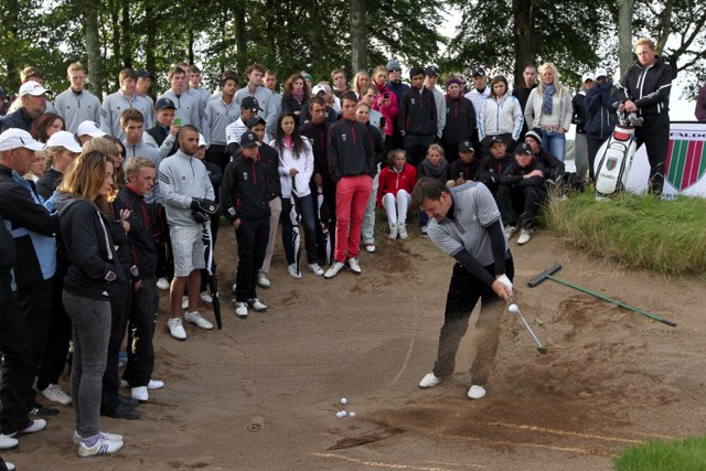 Sir Nick Faldo giving a short game clinic to competitors during the 16th Faldo Series Grand Fina